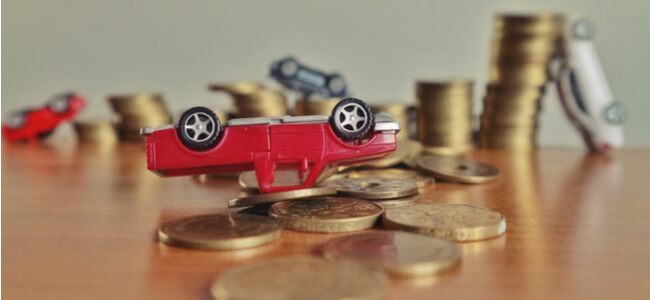 Upside down red car on coins