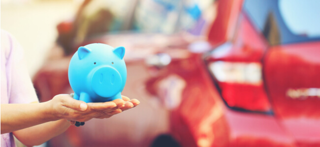 savings piggy bank on the background car
